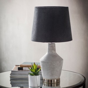 Stone effect table lamp with a black shade